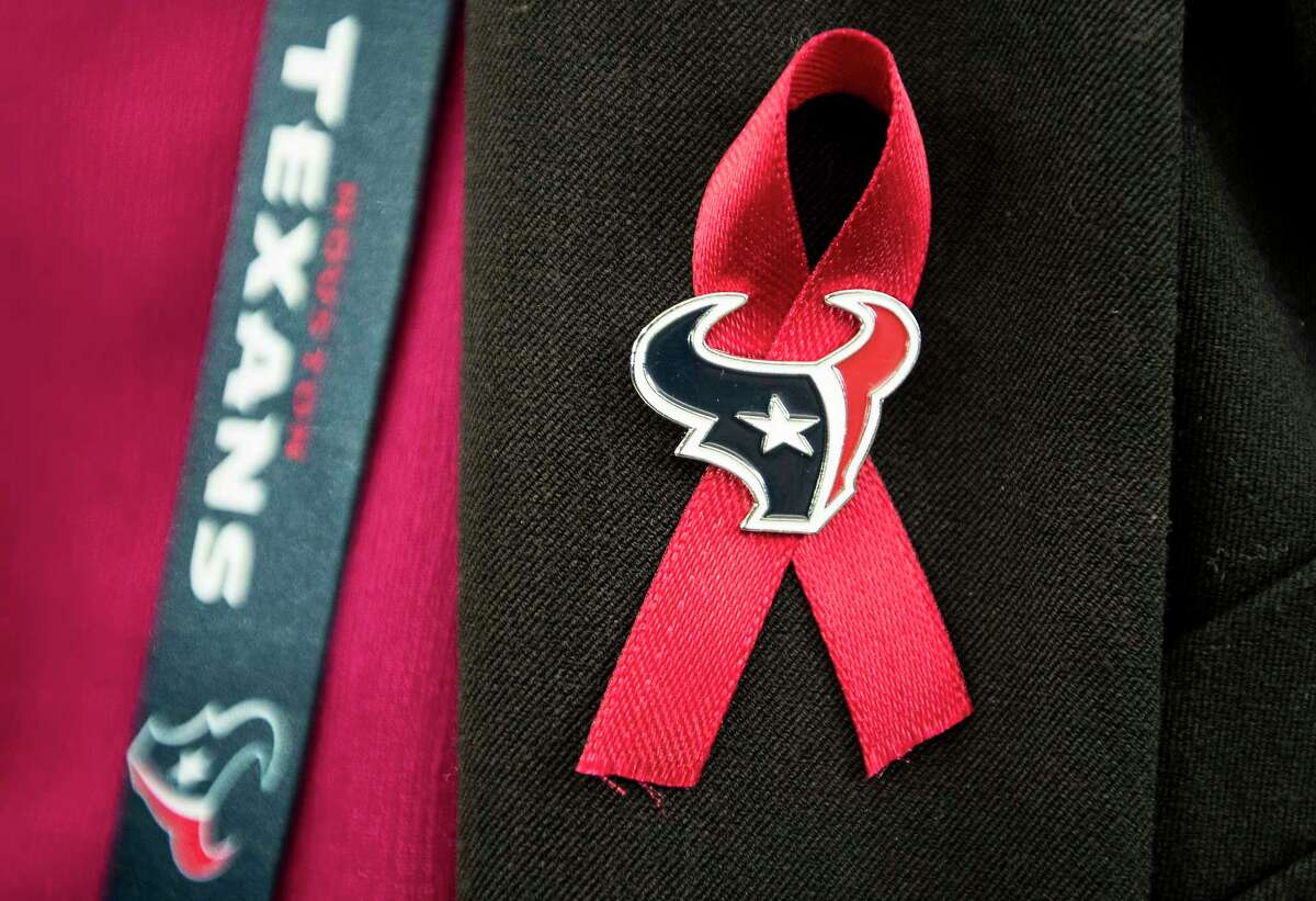 A ribbon honoring the late Robert C. McNair, who died last week, is worn on a lapel before an NFL football game against the Tennessee Titans at NRG Stadium on Monday, Nov. 26, 2018, in Houston.