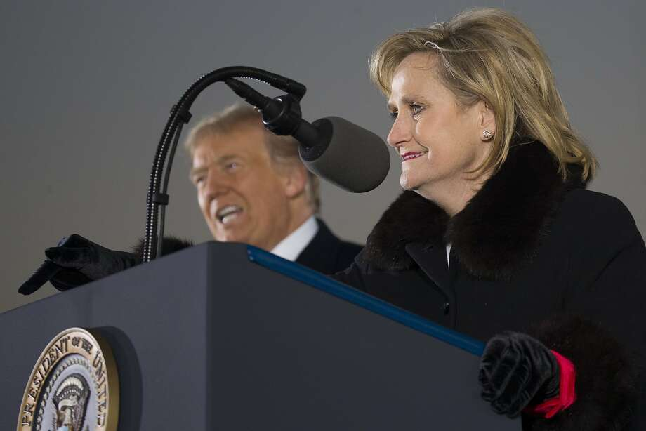 President Trump joins Sen. Cindy Hyde-Smith, R-Miss., at a campaign rally in Tupelo. She faces Democrat Mike Espy, a former congressman and U.S. agriculture secretary. Photo: Alex Brandon / Associated Press