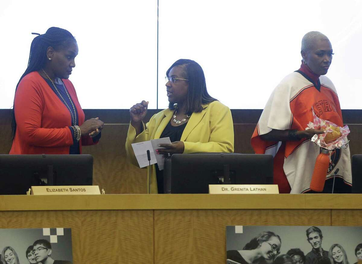 Wanda Adams, left, Grenita Lathan, center, and Jolanda Jones, right, arrive to the Houston ISD school board meeting Thursday, Oct. 18, 2018.The three trustees who supported suspending the search - Adams, Jones and Rhonda Skillern-Jones - have all advocated for permanently retaining Lathan.
