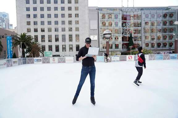 Ben Matthews, manager of ice skating rink in Civic Center Plaza, tends to a task on his laptop at the Union Square ice skating rink on Monday, November 26, 2018 in San Francisco, Calif.    Matthews perfroms under the stage name Tara Lipsyncki.