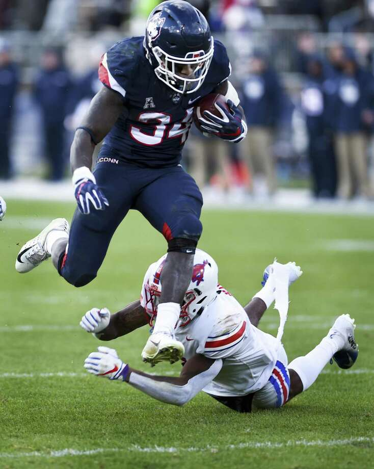 Connecticut running back Kevin Mensah (34) runs over SMU safety Elijah McQueen (6) in the second half on the way to score during an NCAA college football game, Saturday, Nov. 10, 2018, in East Hartford, Conn.(AP Photo/Stephen Dunn) Photo: Stephen Dunn / Associated Press / Copyright 2018 The Associated Press. All rights reserved