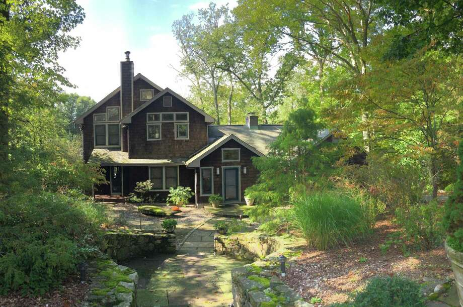 The 3,367-square-foot contemporary home has three bedrooms and three full baths on more than a half-acre that is partially wooded. Photo: William Raveis Real Estate / ONLINE_CHECK