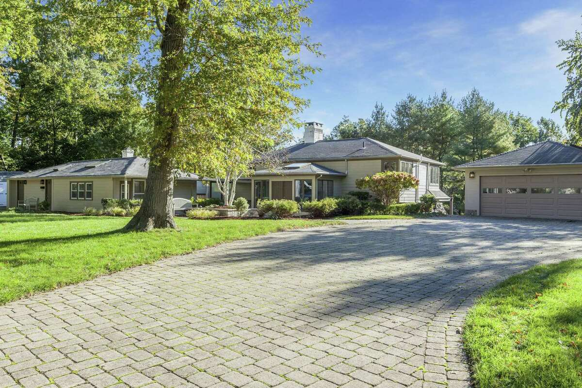 In addition to the detached garage, the contemporary at 39 Orchard Hill Road in Norwalk features a cottage with its own heating system, its own driveway and separate parking.