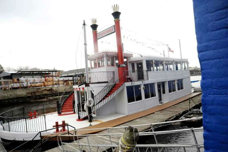"The party boat ""Showboat"" is docked and prepared to be moved overseas on a cargo ship from Port Chester, N.Y. Monday, Nov. 26, 2018. The 110-foot paddle wheel steam boat, once known as the ""Mark Twain,"" was well-known for hosting parties and dockside gatherings at the former Showboat Hotel, now the Delamar."