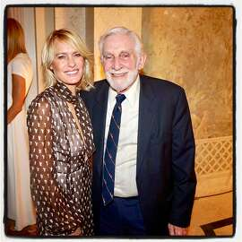 Robin Wright and Dr. Mervyn Silverman at the Amfar Charity Poker Tournament. Nov 17, 2018