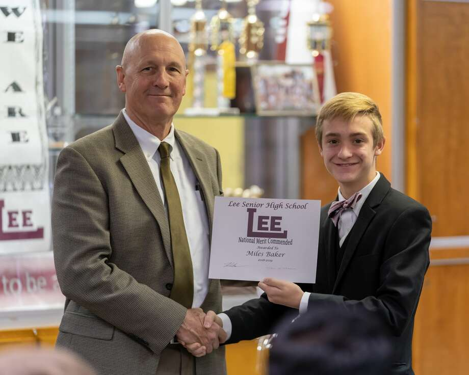 Lee High School recognized students' academic achievements in a ceremony on Nov. 13. Among those honored was Miles Baker, right, who was named a National Merit Commended Scholar and AP Scholar. Principal Stan VanHoozer, left, hosted the recognition ceremony. Photo: Courtesy Midland ISD