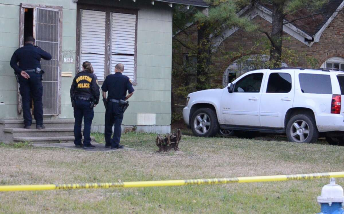 Houston police officers investigate a deadly shooting in the 8100 block of Ogden Street on Monday, Nov. 26, 2018.