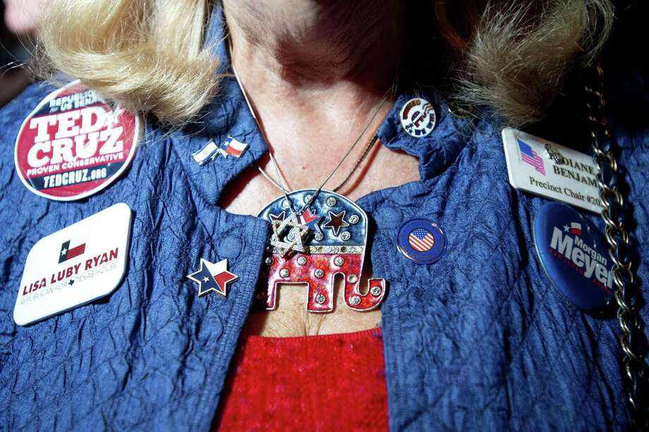 Diane Benjamin, a Dallas precinct chairman, sports campaign buttons and Republican themed jewelry during the Dallas County Republican Party election night watch party on Tuesday, Nov. 6, 2018 at The Statler Hotel in Dallas. (AP Photo/Jeffrey McWhorter) Photo: Jeffrey McWhorter, FRE / Associated Press / FR170451 AP
