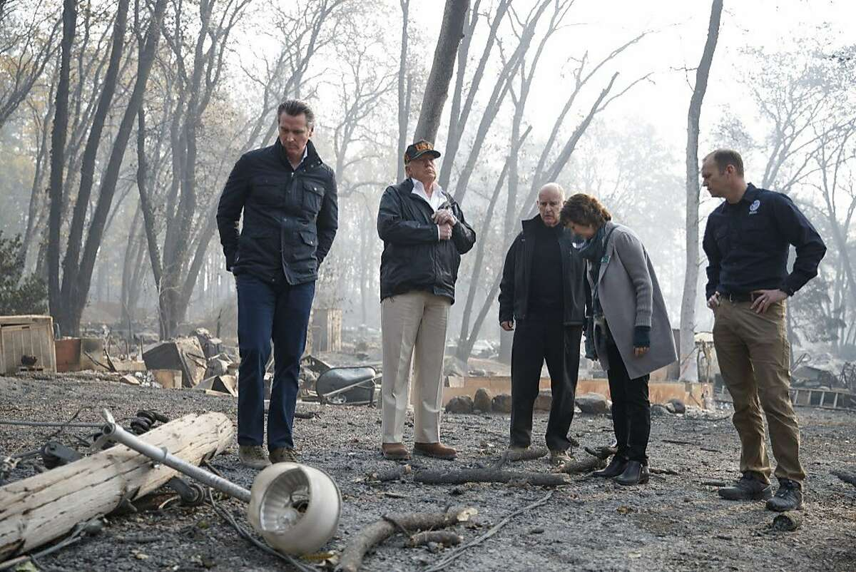 President Donald Trump tours fire-ravaged homes in Paradise, Calif., Nov. 17, 2018. The Federal Emergency Management Agency, often maligned for its response to prominent natural disasters, is quietly helping California respond to and recover from the wildfires across the state, including the deadliest in the state's recorded history. From left: Gavin Newsom, the governor-elect; Trump; Gov. Jerry Brown; Jody Jones, the mayor of Paradise; and Brock Long, the FEMA director. (Tom Brenner/The New York Times)
