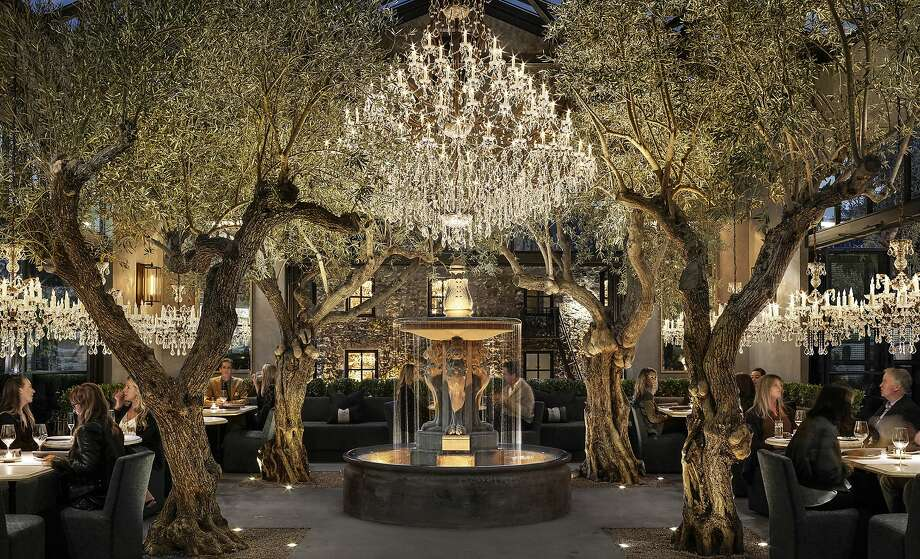 The indoor-outdoor restaurant at RH Yountville features a French limestone fountain and crystal chandeliers. Photo: RH