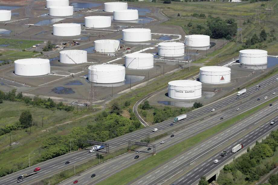 FILE - In this Sept. 8, 2008 file photo, traffic on I-95 passes Citgo oil storage tanks in Linden, N.J. Venezuela will hold onto its U.S.-based Citgo refineries, settling in Nov. 2018 a dispute that threw ownership of the struggling country's prized assets into peril. (AP Photo/Mark Lennihan, File) Photo: Mark Lennihan, STF / Associated Press / AP2008