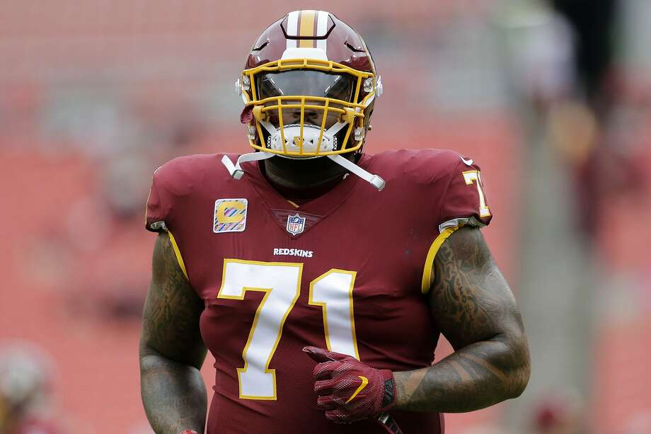FILE - In this Oct. 17, 2017, file photo, Washington Redskins offensive tackle Trent Williams warms up prior to an NFL football game against the San Fransisco 49ers in Landover, Md. Photo: Mark Tenally / Associated Press