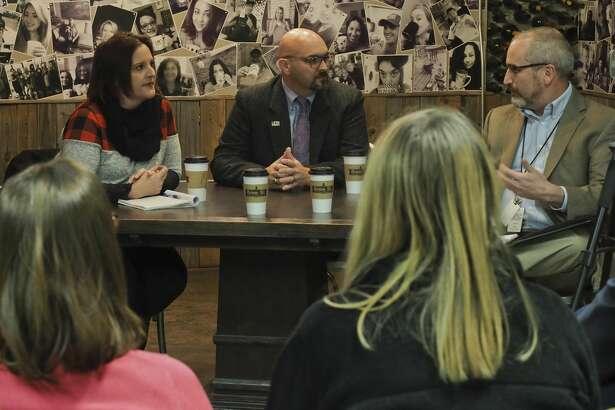Heidi Kirk and John Trischitti, in a run-off for MISD district 5 school board seat, discuss education topics 11/26/18 during an MRT Facebook live forum at Brew St. Bakery with editor Stewaret Doreen. Tim Fischer/Reporter-Telegram