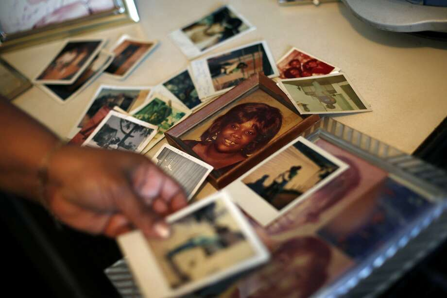 In this Tuesday, March 12, 2013 photo, Brenda Gordon looks at photos of her mother, Carol Alford, at her apartment in Los Angeles. Alford was allegedly murdered by Samuel Little in 1987. Photo: Jae C. Hong, Associated Press