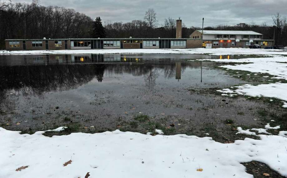 The flooded athletic field at Cranbury Elementary School in Norwalk earlier this month. Photo: Erik Trautmann / Hearst Connecticut Media / Norwalk Hour