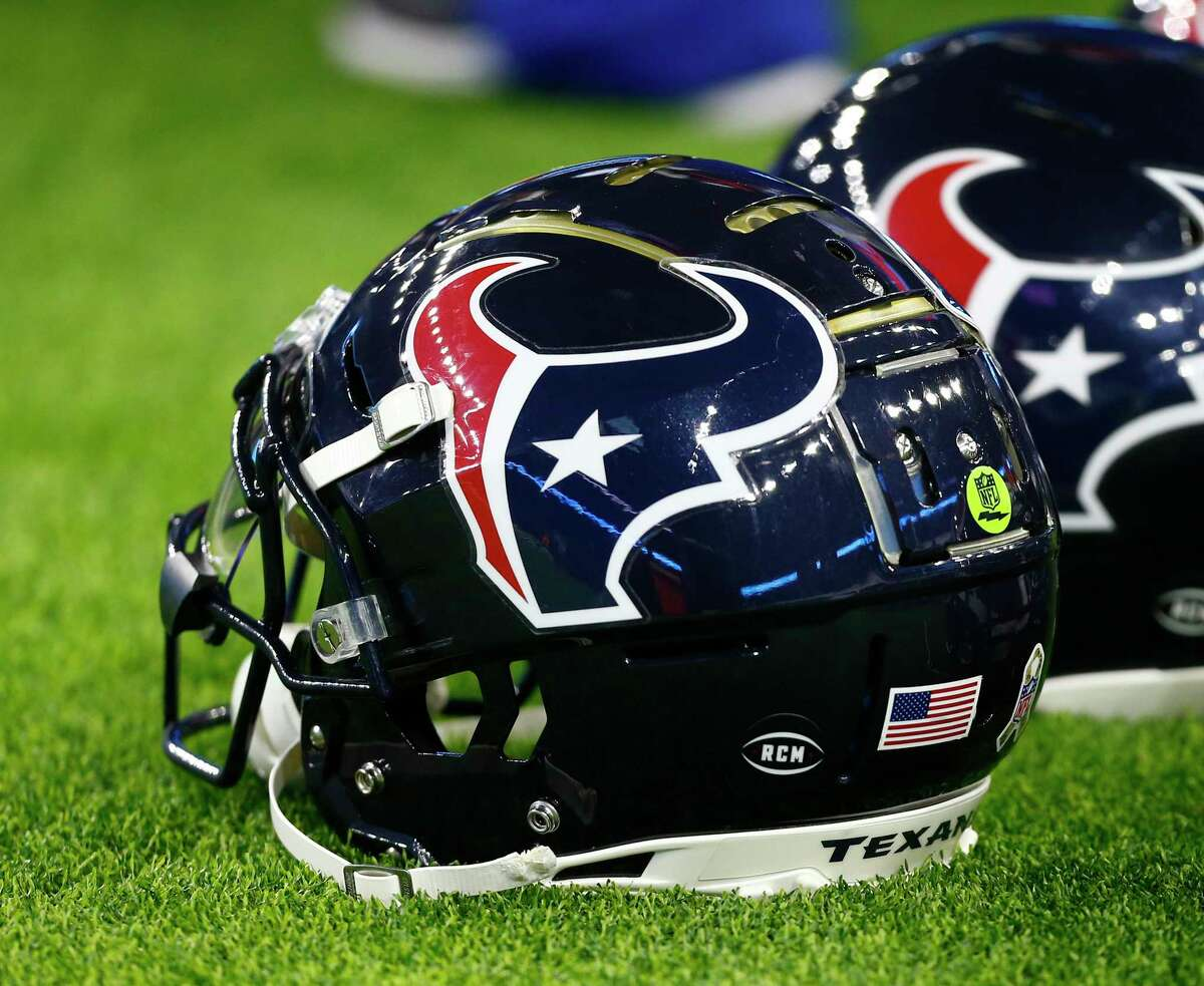 HOUSTON, TEXAS - NOVEMBER 26: A view of the helmet sticker honoring Robert C. McNair, the late owner of the Houston Texans, is shown prior to the game against the Tennessee Titans at NRG Stadium on November 26, 2018 in Houston, Texas.