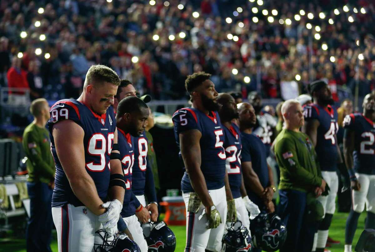 Houston Texans defensive end J.J. Watt (99) listens as Amazing Grace is sung in tribute to Texans owner Bob McNair before the first quarter of an NFL football game at NRG Stadium on Monday, Nov. 26, 2018, in Houston.