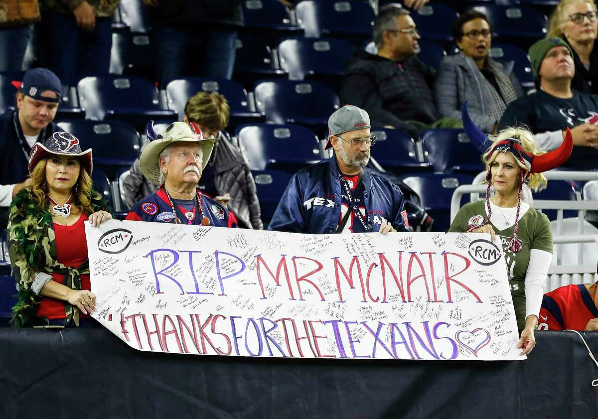 Texans fans hold a sign for Texans owner Bob McNair before the start of an NFL football game at NRG Stadium, Monday, Nov. 26, 2018, in Houston.