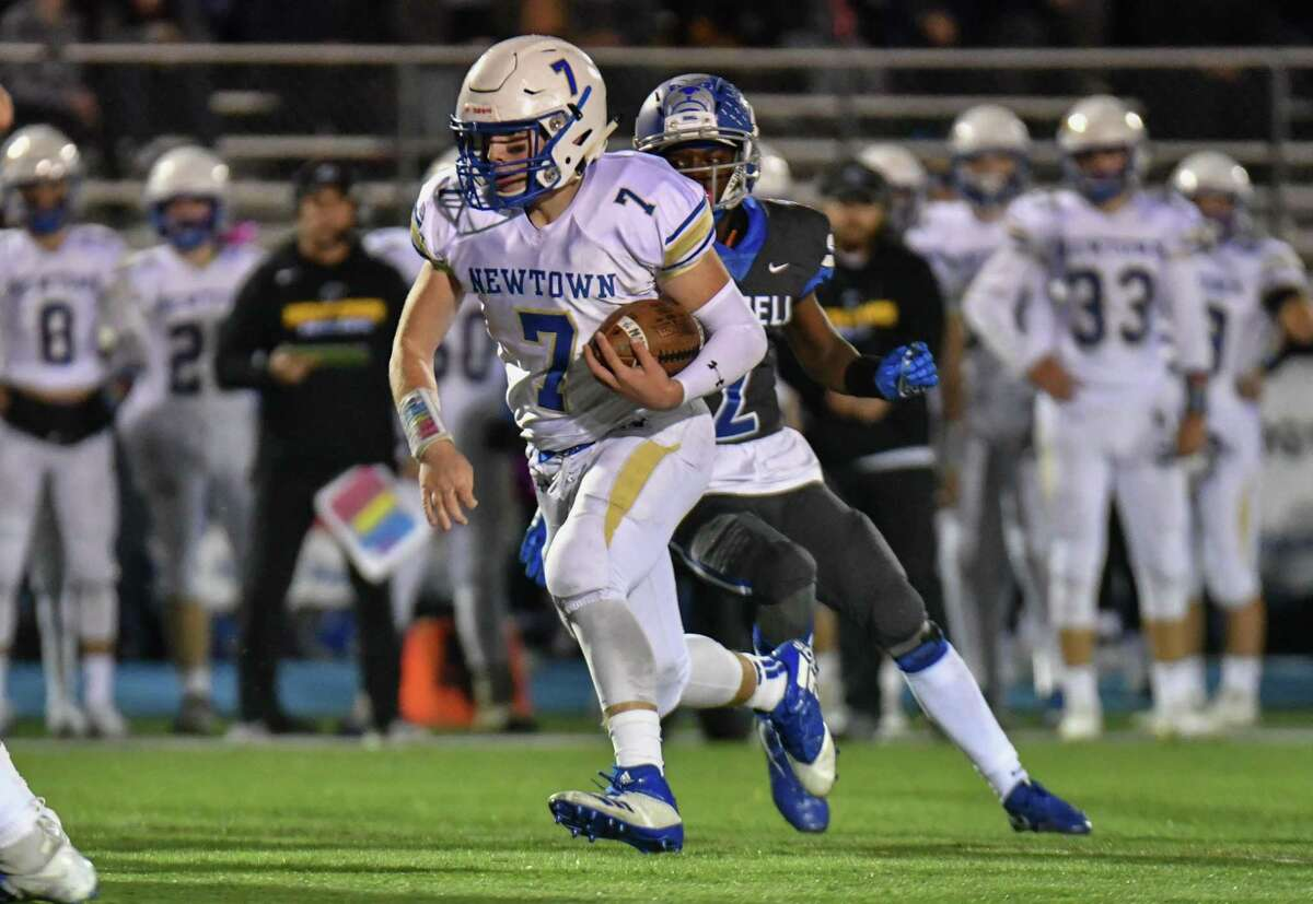 Dan Mason (7) of the Newtown Nighthawks finds plenty of running room during a game against the Bunnell Bulldogs on Oct. 26, 2018, at Bunnell High School in Stratford.