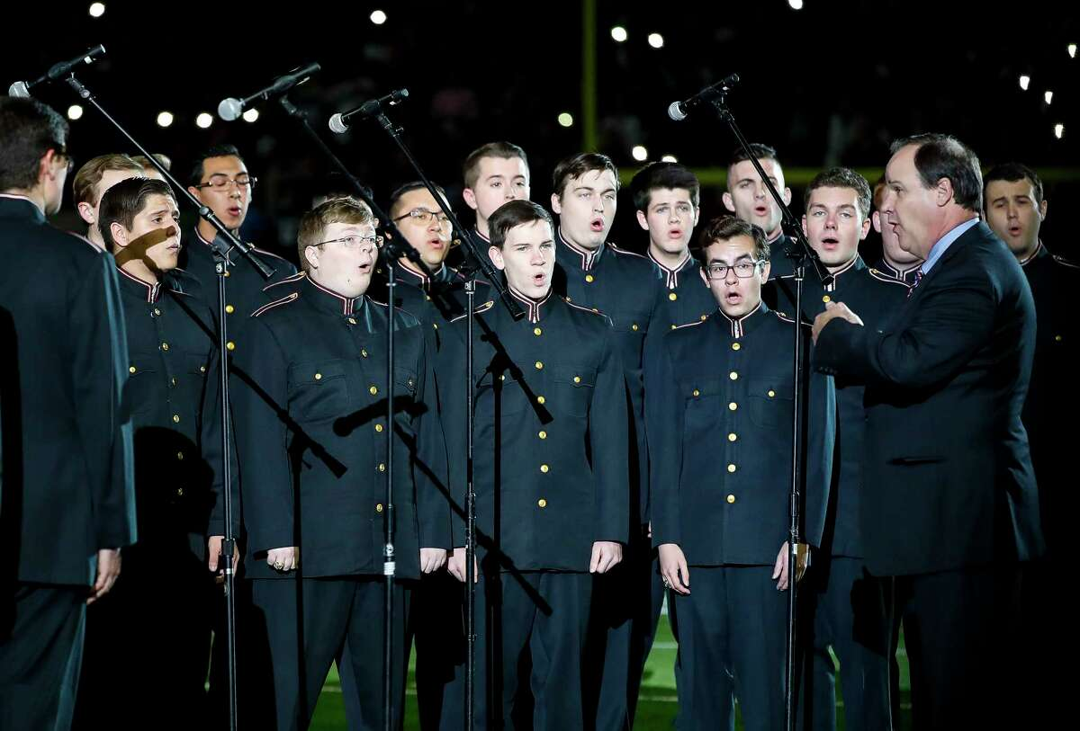 The Texas A&M University Singing Cadets sing Amazing Grace before the start of an NFL football game at NRG Stadium, Monday, Nov. 26, 2018, in Houston.