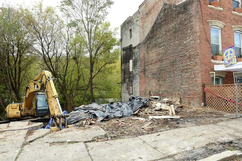 Construction site at 170 Orange St. where the Graham_Johnson family used to live Friday, pictured on Oct. 26, 2018 in Albany, N.Y. The family's home was torn down after a city contractor left one side of it exposed while demolishing the property next door. (Lori Van Buren/Times Union) Photo: Lori Van Buren / 40045295A