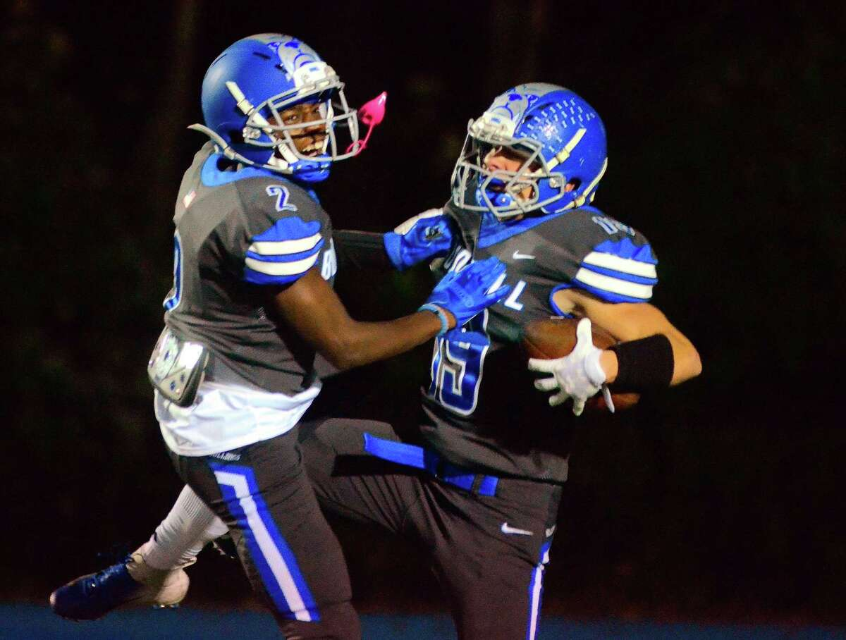 Bunnell's James Savko (19) celebrates with teammate Eli Alexandre after scoring a touchdown against Masuk in Stratford on Oct. 19.