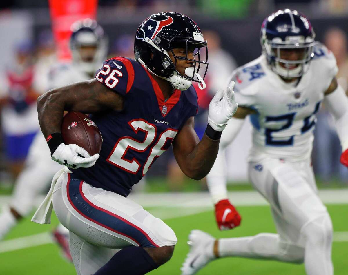PHOTOS: From the Texans-Titans game on Monday Night Football Houston Texans running back Lamar Miller (26) breaks through the Titans defense on a 97-yard touchdown run during the second quarter of an NFL football game at NRG Stadium on Monday, Nov. 26, 2018, in Houston.