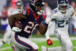 Houston Texans running back Lamar Miller (26) breaks through the Titans defense on a 97-yard touchdown run during the second quarter of an NFL football game at NRG Stadium on Monday, Nov. 26, 2018, in Houston.