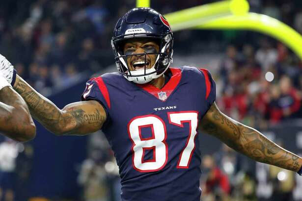 Houston Texans wide receiver Demaryius Thomas (87) celebrates his touchdown with quarterback Deshaun Watson (4) during the first quarter of an NFL football game at NRG Stadium, Monday, Nov. 26, 2018, in Houston.