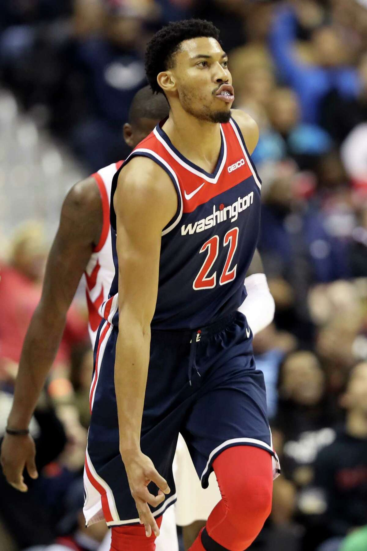WASHINGTON, DC - NOVEMBER 26: Otto Porter Jr. #22 of the Washington Wizards celebrates after hitting a three pointer in the first half against the Houston Rockets at Capital One Arena on November 26, 2018 in Washington, DC. NOTE TO USER: User expressly acknowledges and agrees that, by downloading and or using this photograph, User is consenting to the terms and conditions of the Getty Images License Agreement.