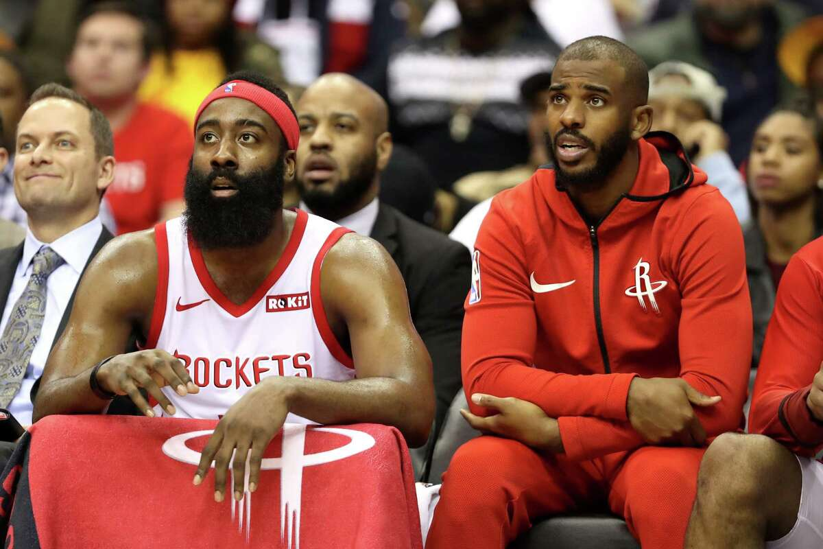WASHINGTON, DC - NOVEMBER 26: James Harden #13 and Chris Paul #3 of the Houston Rockets (R) talk on the bench in the first half against the Washington Wizards at Capital One Arena on November 26, 2018 in Washington, DC. NOTE TO USER: User expressly acknowledges and agrees that, by downloading and or using this photograph, User is consenting to the terms and conditions of the Getty Images License Agreement.