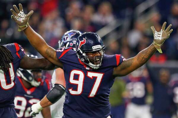 Houston Texans defensive end Angelo Blackson (97) celebrates during the third quarter of an NFL football game at NRG Stadium on Monday, Nov. 26, 2018, in Houston.