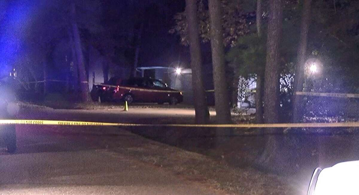 Authorities investigate a shooting outside a home along North Timber Top Drive Monday evening in the Tall Forest subdivision in The Woodlands.