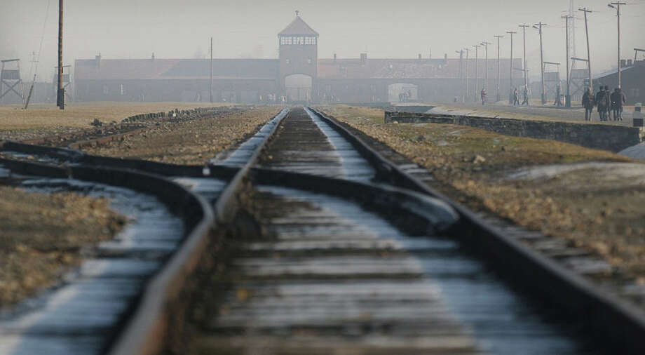 Rails lead to the former Nazi death camp Auschwitz-Birkenau in Oswiecim, southern Poland, in this file photo. A controversial Burning Man art installation that showed Barbie dolls being marched into ovens at last week's festival is reportedly being investigated by the Anti-Defamation League in San Francisco. Photo: CZAREK SOKOLOWSKI / AP