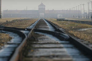 Rails in  the former Nazi death camp Auschwitz-Birkenau are shown Jan. 17, 2005, in Oswiecim, southern Poland. An estimated 600,000 people visit the camp each year to learn or to grieve, and the majority move about the complex quietly and in a spirit of reverence.  (AP Photo/Czarek Sokolowski)