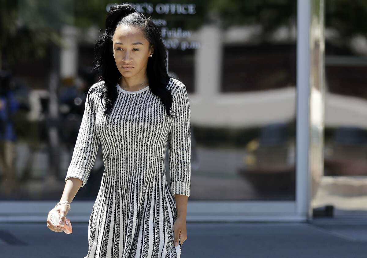 Elissa Ennis, former girlfriend of San Francisco 49ers linebacker Reuben Foster, walks out of Santa Clara County Superior Court after testifying in Foster's preliminary hearing, Thursday, May 17, 2018, in San Jose, Calif. Foster pleaded not guilty Tuesday, May 8, 2018, to charges stemming from allegations that he attacked Ennis in their home in February. (AP Photo/Marcio Jose Sanchez)