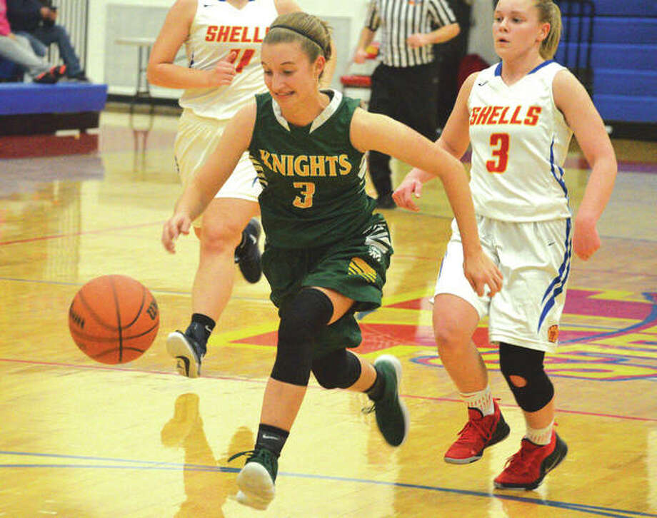 Metro-East Lutheran senior Sami Kasting, left, chases down the basketball during the first quarter of Monday's game at Roxana. Photo: Scott Marion/Intelligencer