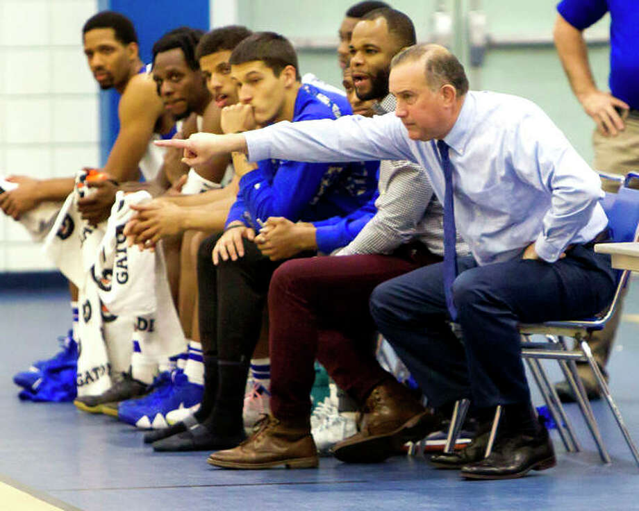 Lewis and Clark Community College men's basketball coach Doug Stotler, right, directs his team during Monday's victory over Lindenwood-Belleville at the Riverbend Arena. LCCC won, giving Stotler his 400th career coaching victory. Seated next to Stotler is assistant coach Kavon Lacey. Photo: Jan Dona | For The Telegraph