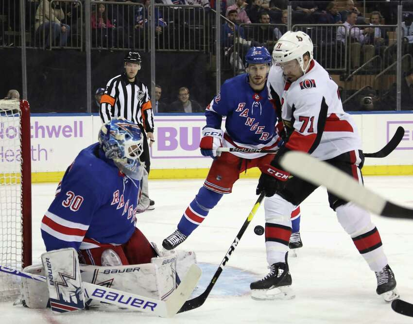 NEW YORK, NEW YORK - NOVEMBER 26: Henrik Lundqvist #30 of the New York Rangers makes the first period save on Chris Tierney #71 of the Ottawa Senators at Madison Square Garden on November 26, 2018 in New York City. (Photo by Bruce Bennett/Getty Images)
