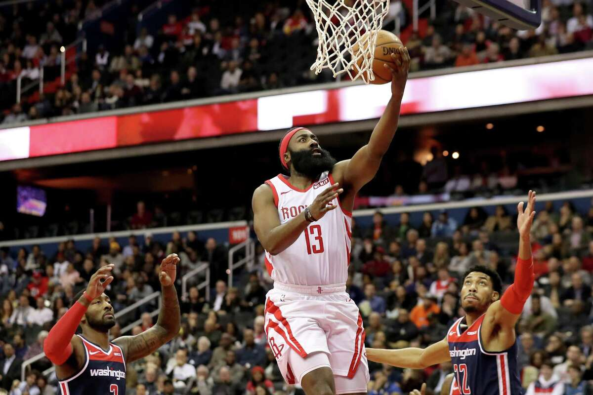 The Rockets' James Harden has a good look on his drive as he beats the Wizards' Otto Porter on his way to 54 points. Harden was 17-for-32 from the field.