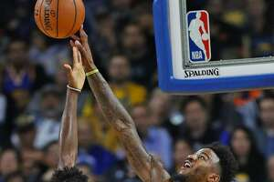 Golden State Warriors' Jordan Bell blocks  shot by Orlando Magic's Jonathan Isaac in 2nd quarter during NBA game at Oracle Arena in Oakland, Calif. on Monday, November 26, 2018.