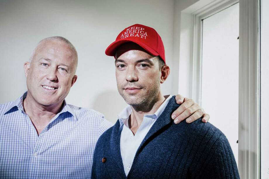 "Married couple Bill White, left, and Bryan Eure in their home in Atlanta, Oct. 16, 2018. White and Eure, who split their time between Georgia and New York, supported Barack Obama and Hillary Clinton, but now they are fundraising for President Donald Trump and have his sons numbers on speed dial. ""I'm not a wallower in self-pity,"" White said of the switch. (Melissa Golden/The New York Times) Photo: MELISSA GOLDEN, STR / NYT / NYTNS"