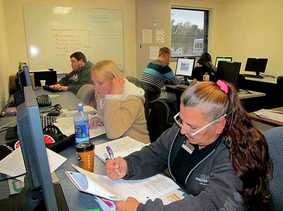 Education and Training Connection students study in the adult education classroom at the ETC, 884 E. Isabella Road, just west of Midland. (Daily News file photo)