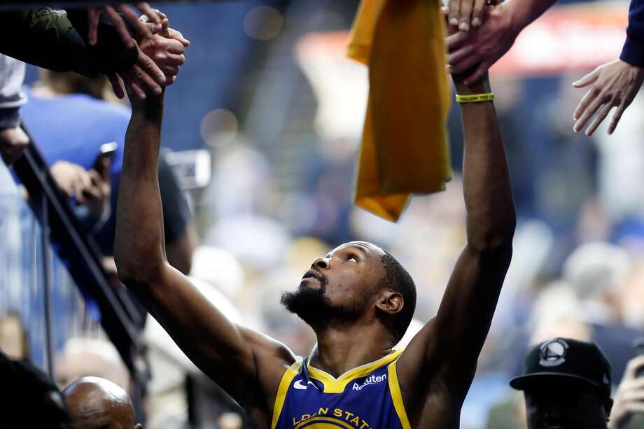 Kevin Durant of Golden State Warriors interacts with fans after scoring 49 points during the 116-110 win over Orlando Magic during the NBA game at the Oracle Arena in Oakland, California, on Monday, November 26, 2018. Photograph: Scott Strazzante / The Chronicle
