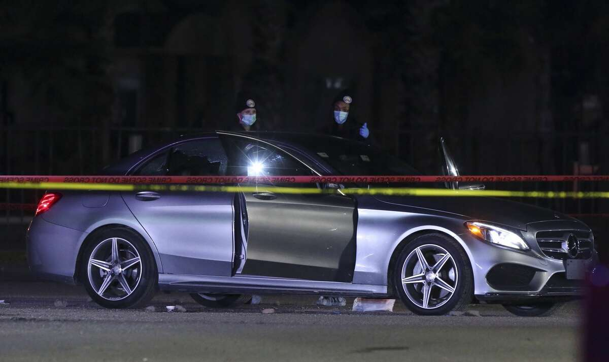 HPD authorities investigate the scene where two men found shot to death in a silver Mercedes-Benz early morning at the Club Onyx back parking lot on Tuesday, Nov. 27, 2018, in Houston.
