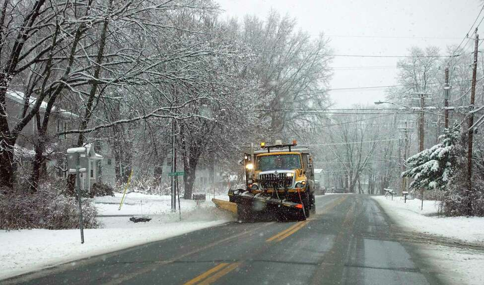 A snow plow operator clears snow on Altamont Road on Tuesday, Nov. 27, 2018, in Voorheesville, N.Y (Paul Buckowski/Times Union)