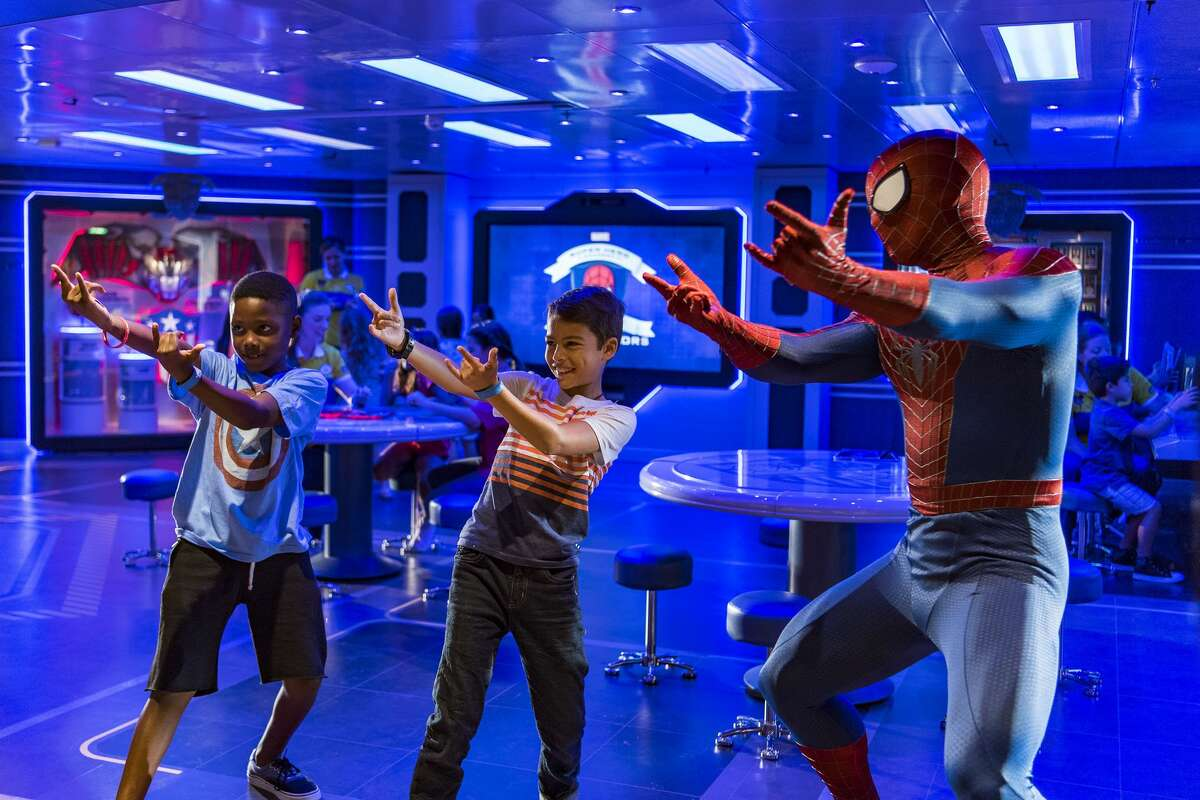 On the Disney Wonder, young guests get a special visit from Spider-Man while training at the Marvel Super Hero Academy in Disney's Oceaneer Club.(Matt Stroshane, photographer)