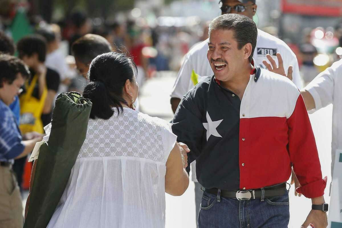 Adrian Garcia, shown shaking hands during the 50th Annual Houston Fiestas Patrias in September in Houston, says he will stage town hall meetings and special events as Harris County's Precinct 2 commissioner. Garcia defeated Jack Morman in the November election for the post.