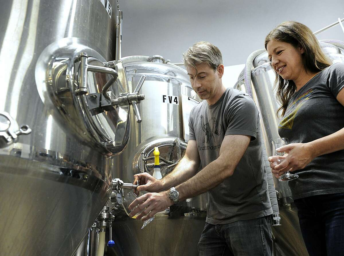 Chris Sanzeni, and Lisa Tassone, co-owners along with Paul Mannion of Broken Symmetry Gastro Brewery in Bethel, test sample beer Thursday, June 21, 2018. Beer package pick-up: Participants can pick up their beer package at any participating brewery location Sept. 15-17, from 2 to 8 p.m. Participants must be 21 or older, with valid ID, to pick up. They also will need to bring their ticket and credit card used for purchase. Also beers should be refrigerated once home, organizers noted. Package contents: The package contains 10 full, 16-oz cans of beers. Organizers said the package is made for one to three people, with one person