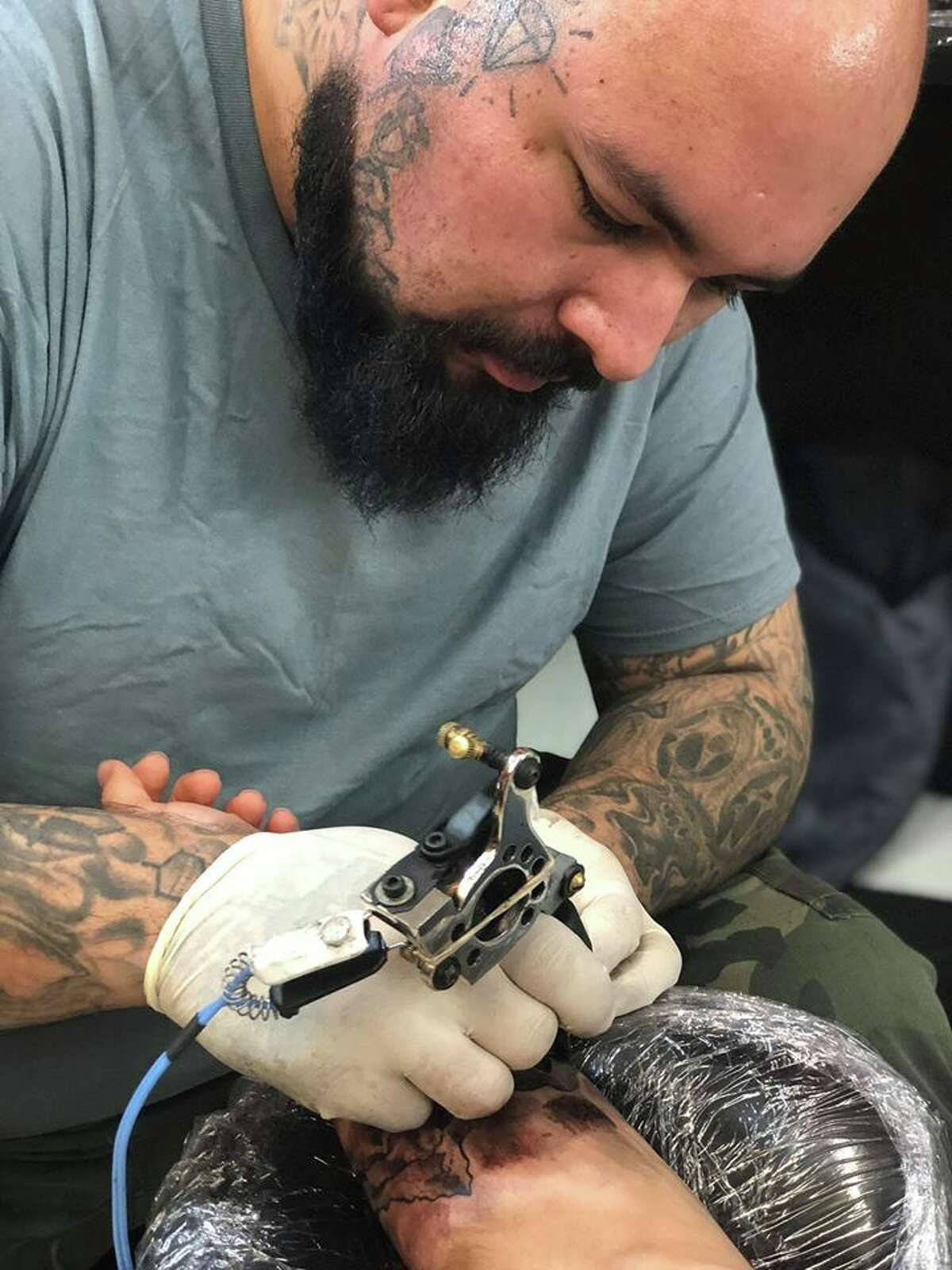 Xavier Avila, 29, was fatally shot Monday during an argument at a West Side bar. He was a tattoo artist for Nite Owl Tattoo Studio and the father of a 7-year-old daughter, Aalyah.